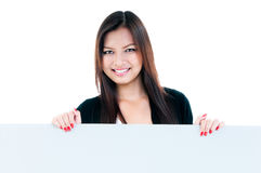 Happy Young Woman Holding Blank Board. Portrait of an attractive young woman holding blank board against white background Stock Image