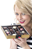 Happy Young Woman Holding Box of  Chocolates Stock Photos