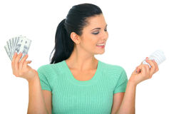 Happy Young Woman Holding Bulb. Save energy concept. young woman holding bulb and money stock image