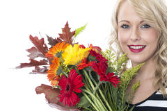 Happy Young Woman Holding a Bunch of Flowers Stock Photos