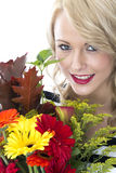 Happy Young Woman Holding a Bunch of Flowers Royalty Free Stock Photography