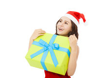 Happy young woman holding a  christmas gift box Royalty Free Stock Photography