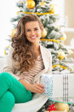 Happy young woman holding christmas present box Royalty Free Stock Image