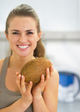Happy young woman holding coconut Royalty Free Stock Photography