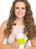 Happy young woman holding coffee cup Royalty Free Stock Images