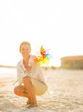 Happy young woman holding colorful windmill toy Stock Photography