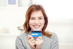 Happy young woman holding credit card. Happy young woman can on line shopping with credit card Royalty Free Stock Image