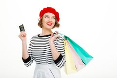Happy young woman holding credit card and shopping bags Royalty Free Stock Photo
