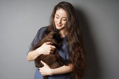 Happy young woman with her pet cat stock photos