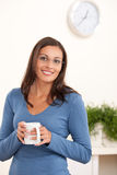 Happy young woman holding cup of coffee Stock Photography