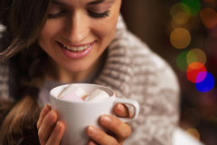Happy young woman holding cup of hot chocolate with marshmallow Stock Image