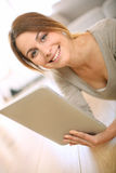 Happy young woman holding digital tablet Royalty Free Stock Images