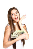 Happy young woman holding dollars on a white background Stock Photos