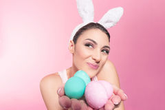 Happy young woman holding easter eggs Stock Photography