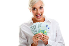 Happy young woman holding euro bills Stock Images