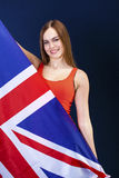 Happy young woman holding a flag of of Great Britain British fl Stock Photography