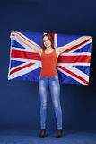 Happy young woman holding a flag of of Great Britain British fl Royalty Free Stock Photos