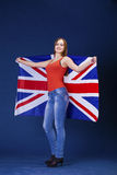 Happy young woman holding a flag of of Great Britain British fl Royalty Free Stock Photo