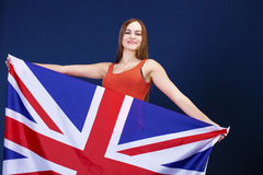Happy young woman holding a flag of of Great Britain British fl Royalty Free Stock Photography