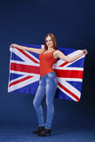 Happy young woman holding a flag of of Great Britain British fl Stock Images