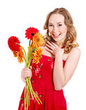 Happy young woman holding flowers. Stock Image