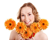 Happy young woman holding flowers. Royalty Free Stock Images