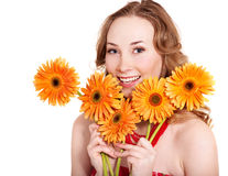 Happy young woman holding flowers. Stock Photo