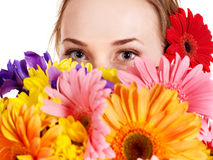 Happy young woman holding flowers. Royalty Free Stock Photos