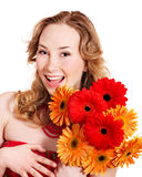 Happy young woman holding flowers. Stock Photography