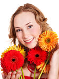 Happy young woman holding flowers. Royalty Free Stock Photography