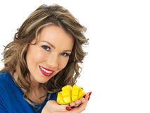 Happy Young Woman Holding a Fresh Ripe Juicy Mango Half Royalty Free Stock Image