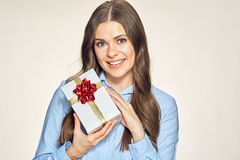 Happy young woman holding gift box. Stock Images