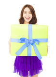 Happy young woman holding a gift box Stock Photos