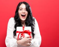 Happy young woman holding a gift box Royalty Free Stock Image