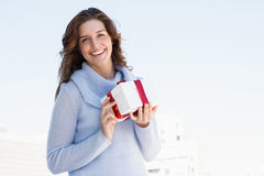 Happy young woman holding gift Royalty Free Stock Photo
