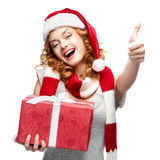 Happy young woman holding gift on white Royalty Free Stock Photos