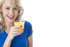 Happy Young Woman Holding Glass of Fresh Orange Juice Royalty Free Stock Photos
