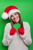 Happy young woman holding green heart shaped paper Royalty Free Stock Photos