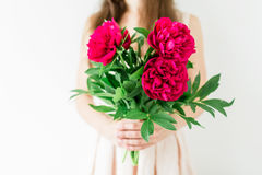 Happy young woman holding in hands peony bouquet. Sweet romantic moment Royalty Free Stock Image