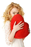 Happy young woman holding heart. Valentines day. Stock Photo