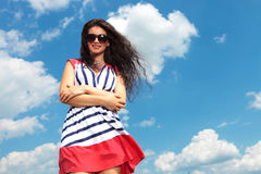 Happy young woman holding her hands crossed Stock Image