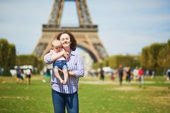 Happy young woman holding her little baby girl in Paris stock photography