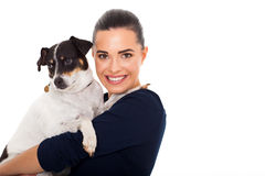 Woman holding pet. Happy young woman holding her pet dog on white background Royalty Free Stock Image