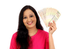 Happy young woman holding Indian rupee bank notes Royalty Free Stock Photography
