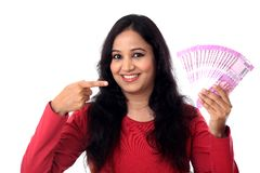 Happy young woman holding Indian 2000 rupee notes Stock Photography