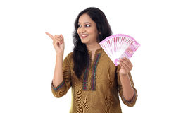Happy young woman holding Indian 2000 rupee notes Stock Photos