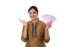 Happy young woman holding Indian 2000 rupee notes Royalty Free Stock Photo