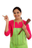 Happy young woman holding kitchen utensil Royalty Free Stock Images