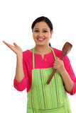 Happy young woman holding laddle Stock Image