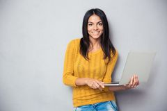 Happy young woman holding laptop Royalty Free Stock Photo